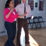 Commissioner Smith and Councilor Chase practice the foxtrot.